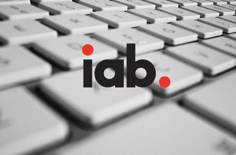 Logo of Interactive Advertising Bureau with keyboard in background